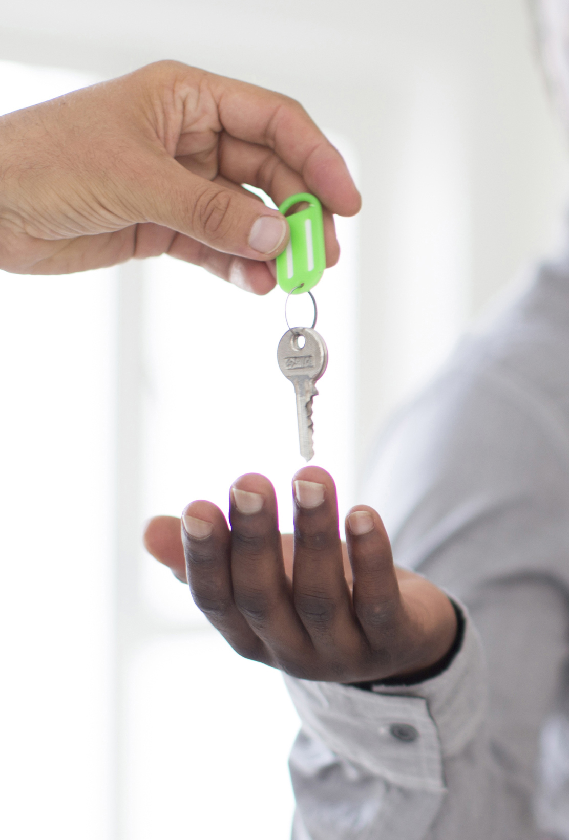 Realtor giving couple keys to new home